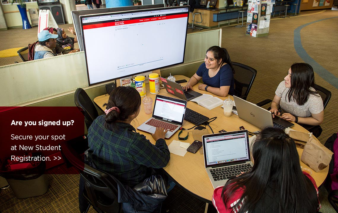 Four students at desk in UC