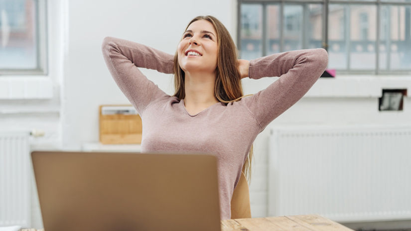 Woman relaxing near computer smiling
