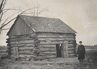 Polk County pioneer Theodore L. Hansen next to his Lincoln Twp. cabin, ca. 1876