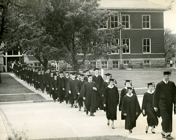 Graduates marching from South Hall to North Hall, May 1954