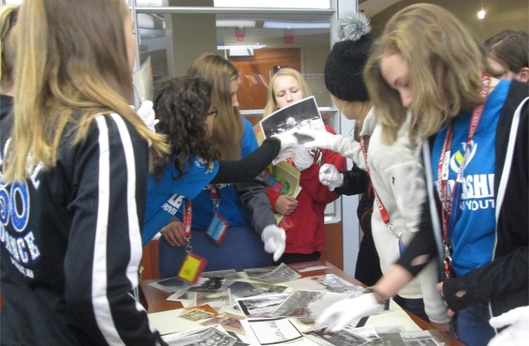 Students using photographs in the Archives