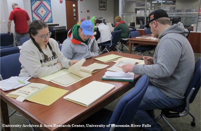 Students using archival materials for a class