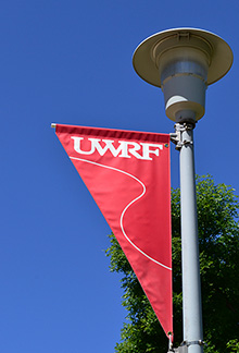 UWRF light pole banner on a blue-sky day