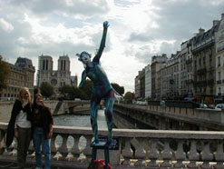 Students Pose By Statue On Bridge Over Seine