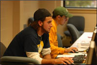 Student using computer lab in library