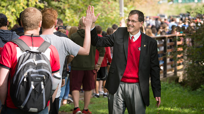 dean academic day high five