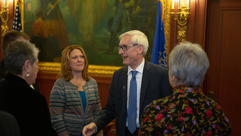 Jennifer Peterson with Gov. Evers