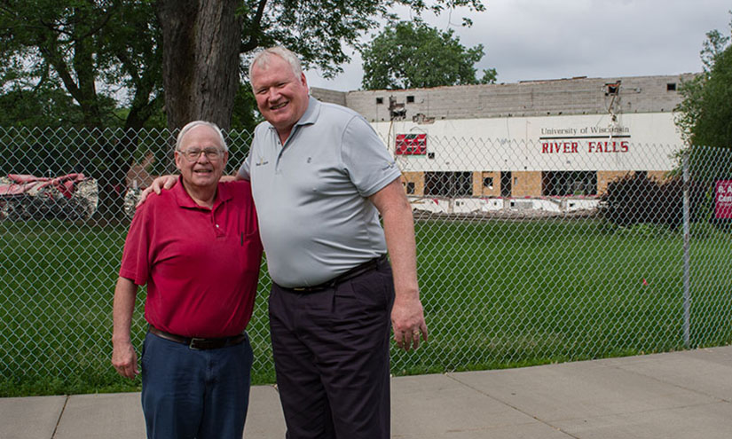 Former Assistant Director of Admissions and longtime voice of the Falcons George Hansen (left) stands with Dan McGinty in front of Karges Center during deconstruction earlier this month.
