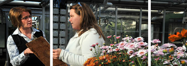 Horticulture student confers with professor.