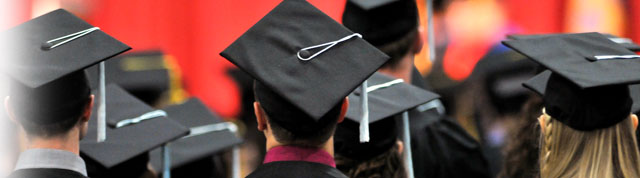 Students wearing mortarboard caps