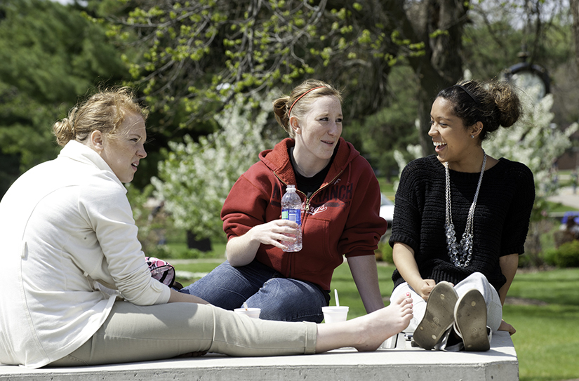 Relaxing between classes at UWRF's scenic campus.