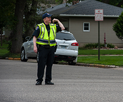 Officer directing traffic during Move In Day